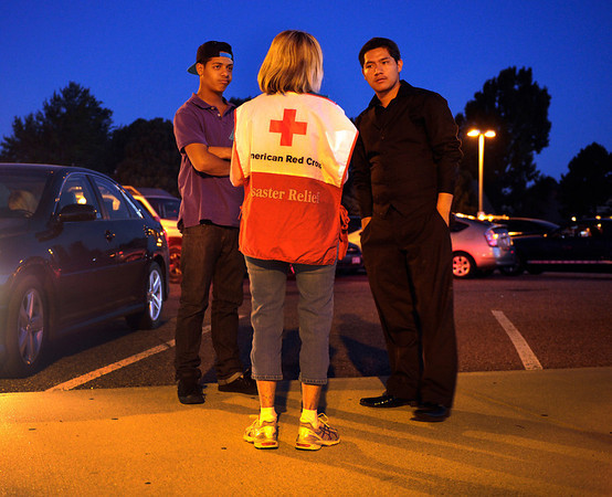 Darius Jenardy, left, and Miguel Corral, right, talked with a Red Cross counselor at Gateway High School Friday morning. They haven't been able to contact friends that have been at the movie. Aurora Police responded to the Century 16 movie theatre early Friday morning, July 20, 2012. Fourteen persons were killed when a lone shooter opened fire inside the theatre during a midnight screening of The Dark Knight Rises. Karl Gehring/The Denver Post