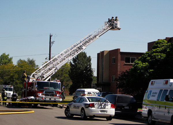 Police use the bucket on a fire truck to look down on an apartment where the suspect in a theatre shooting lived in Aurora, Colo., on Friday, July 20, 2012. As many as 12 people were killed and 50 injured at a shooting at the Century 16 movie theatre on Friday.  The suspect is identified as 24-year-old James Holmes.  (AP Photo/Ed Andrieski)