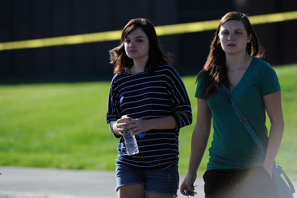People leave Gateway High School in Aurora, CO, where witnesses we being interviewed by authorities Friday, July 20, About 50 people were shot 12 fatally early Friday when shots rang out at an Aurora movie theater during a premiere showing of the new Batman movie. A 24-year-old man in is custody 2012. Craig F. Walker, The Denver Post