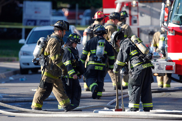 Firefighter work in front of  an apartment where the suspect in a theatre shooting lived in Aurora, Colo., on Friday, July 20, 2012. As many as 12 people were killed and 50 injured at a shooting at the Century 16 movie theatre on Friday.  The suspect is identified as 24-year-old James Holmes.  (AP Photo/Ed Andrieski)