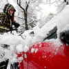 Gabriella Garcia brushes snow off of her car near 10th and Euclid at another spring snow storm hits in Boulder, Colorado May 1, 2013.  DAILY CAMERA/ MARK LEFFINGWELL