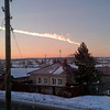 RETRANSMITTING FOR IMPROVE QUALITY In this photo provided by E1.ru a meteorite contrail is seen over a vilage of Bolshoe Sidelnikovo 50 km of Chelyabinsk on Friday, Feb. 15, 2013. A meteor streaked across the sky of Russia's Ural Mountains on Friday morning, causing sharp explosions and reportedly injuring around 100 people, including many hurt by broken glass. (AP Photo/ Nadezhda Luchinina, E1.ru)