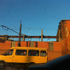 In this photo taken with a mobile phone camera, a minivan passes a zinc factory building with about 600 square meters (6000 square feet) of a roof collapsed in Chelyabinsk on Friday, Feb. 15, 2013. A meteor streaked across the sky of Russia's Ural Mountains on Friday morning, causing sharp explosions and reportedly injuring around 100 people, including many hurt by broken glass. (AP Photo/Valentin Kazakov)