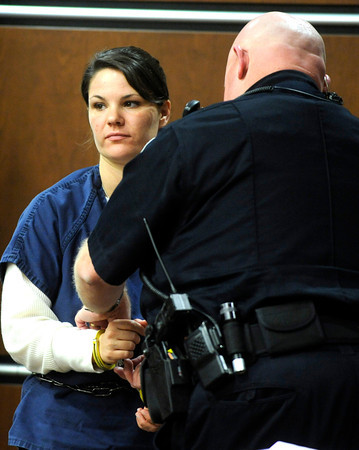 Molly Bowers, (formerly Molly Midyette) is handcuffed during the lunch break after her morning testimony at the Boulder County Justice Center on November 1, 2011. Photo by Paul Aiken