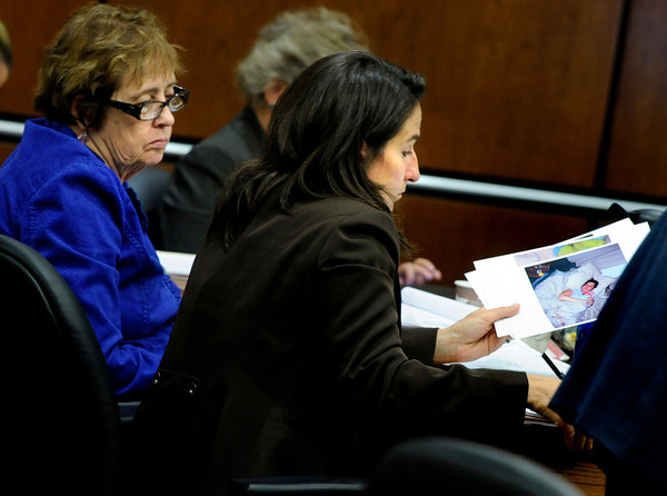 Prosecutor Lisa Scanga looks over evidence photos as Molly Bowers, formerly Molly Midyette, testifies during her hearing at the Boulder County Justice Center on November 1, 2011. Photo by Paul Aiken