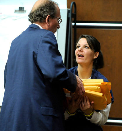 Attorney Thomas Carberry papers over some court paperwork to Molly Bowers, (formerly Molly Midyette) during the lunch break after her morning testimony at the Boulder County Justice Center on November 1, 2011. Photo by Paul Aiken