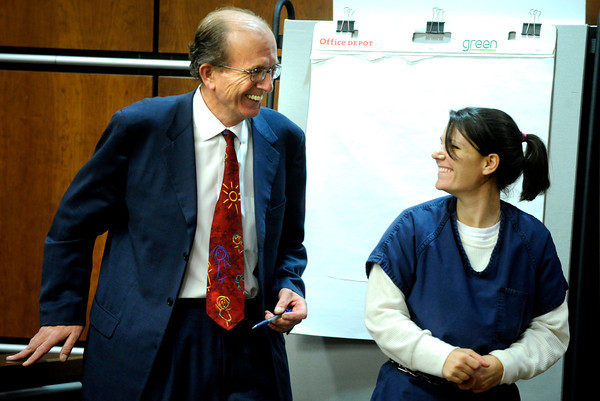 Attorney Thomas Carberry laughs with Molly Bowers, (formerly Molly Midyette) during the lunch break after her morning testimony at the Boulder County Justice Center on November 1, 2011. Photo by Paul Aiken