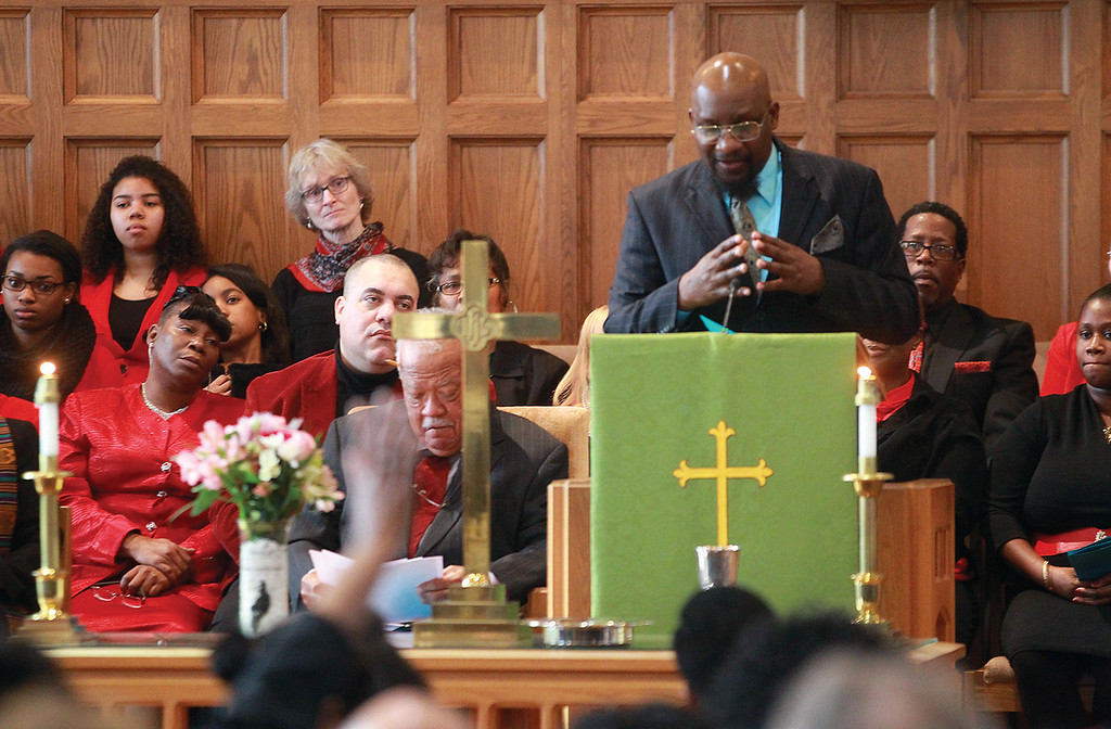 """Spencer Tulis/Finger Lakes Times<br /> Geneva's 46th Annual Martin Luther King Jr. parade and memorial service were held Monday to honor the civil rights icon. It was organized by the Martin Luther King Committee with this year's theme being 'Justice for all!  Reality...or still a dream."""" The host site was the Presbyterian Church in Geneva. Rev. Donald Golden gives the President's Message."""
