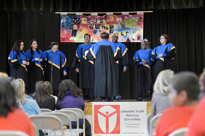 The Second Baptist Church Shekina Glory Choir performs during the Martin Luther King Jr. March for Peace event on Monday, Jan. 21, at Pioneer Bilingual Elementary School in Lafayette. For more photos and video of the event go to www.dailycamera.com Jeremy Papasso/ Camera