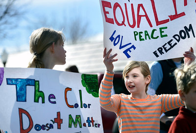 Molly Dever, 9, at left, and Molly Kedlund, 10, talk with each other while marching during the Martin Luther King Jr. March for Peace on Monday, Jan. 21, in Lafayette. For more photos and video of the event go to www.dailycamera.com Jeremy Papasso/ Camera