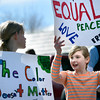 "Molly Dever, 9, at left, and Molly Kedlund, 10, talk with each other while marching during the Martin Luther King Jr. March for Peace on Monday, Jan. 21, in Lafayette. For more photos and video of the event go to  <a href=""http://www.dailycamera.com"">http://www.dailycamera.com</a><br /> Jeremy Papasso/ Camera"