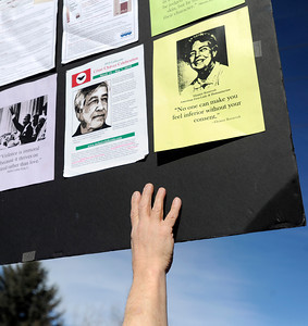 Jay Ruggeri, of Lafayette, holds a sign during the Martin Luther King Jr. March for Peace on Monday, Jan. 21, in Lafayette. For more photos and video of the event go to www.dailycamera.com Jeremy Papasso/ Camera