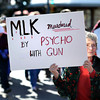"Gene Carroll, of Boulder County, holds a sign during the Martin Luther King Jr. March for Peace on Monday, Jan. 21, in Lafayette. For more photos and video of the event go to  <a href=""http://www.dailycamera.com"">http://www.dailycamera.com</a><br /> Jeremy Papasso/ Camera"