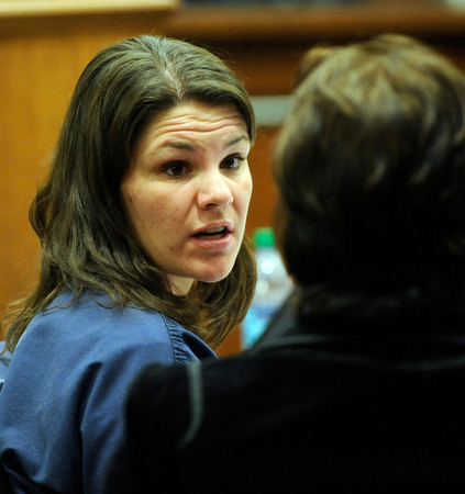 Molly Bowers chats with her attorney Alison Ruttenberg hearing on Wednesday November 16, 2011 at the Boulder County Justice Center. Bowers, formerly Molly Midyette, is asking for a new trial in the death of her son.<br /> Photo by Paul Aiken / The Camera