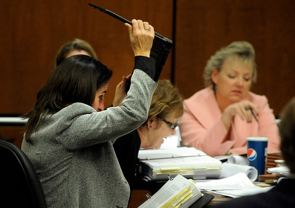 Prosecutor Lisa Scanga lifts her laptop to find a note given to the prosecutors team by Alex Midyette's wife Christine Stonig during Molly Bowers hearing on Wednesday November 16, 2011 at the Boulder County Justice Center. Bowers, formerly Molly Midyette, is asking for a new trial in the death of her son.<br /> <br /> Photo by Paul Aiken / The Camera