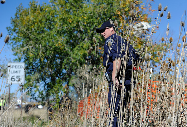 """Missing Girl Search004.JPG Police search for a missing girl named Jessica Ridgeway on Monday, Oct. 8, on the side of highway 36 near the Flatirons Crossing exit in Broomfield. For more photos and video of the search go to  <a href=""""http://www.dailycamera.com"""">http://www.dailycamera.com</a><br /> Jeremy Papasso/ Camera"""
