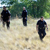 "Missing Girl Search002.JPG Police search for a missing girl named Jessica Ridgeway on Monday, Oct. 8, on the side of highway 36 near the Flatirons Crossing exit in Broomfield. For more photos and video of the search go to  <a href=""http://www.dailycamera.com"">http://www.dailycamera.com</a><br /> Jeremy Papasso/ Camera"