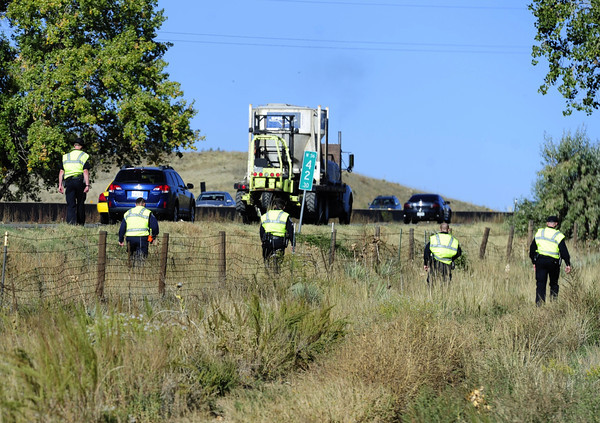A search team combs the ground along US 36 west of McCaslin for clues the the whereabouts of 10-year-old Jessica Ridgeway in Superior , Colorado October 8, 2011. Jessica has been missing since Friday morning.  DAILY CAMERA/ Mark Leffingwell
