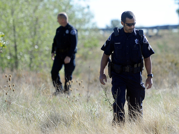 """Missing Girl Search003.JPG Police search for a missing girl named Jessica Ridgeway on Monday, Oct. 8, on the side of highway 36 near the Flatirons Crossing exit in Broomfield. For more photos and video of the search go to  <a href=""""http://www.dailycamera.com"""">http://www.dailycamera.com</a><br /> Jeremy Papasso/ Camera"""