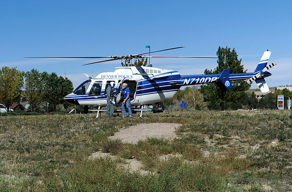 """Missing Girl Search009.JPG Search team members exit a Denver Police helicopter after landing at the Superior Marketplace while in search for a missing girl named Jessica Ridgeway on Monday, Oct. 8. For more photos and video of the search go to  <a href=""""http://www.dailycamera.com"""">http://www.dailycamera.com</a><br /> Jeremy Papasso/ Camera"""