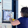 Sami Carroll tapes a flier with photos of Jessica Ridgeway to the map kiosk at the Coatlon Trail Head in Superior, Colorado October 8, 2012. Carroll lives nearby and wanted to help with search by getting fliers made and posting them around Superior. BOULDER DAILY CAMERA/ Mark Leffingwell