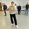 "20120215_PARKINSONS_DANCE_5.jpg Susan Burton, 66, shows fellow students a new step during the ""Movin' With Parkinson's"" dance class Wednesday afternoon Feb. 15, 2012 at Longmont Dance Theatre. (Lewis Geyer/Times-Call)"