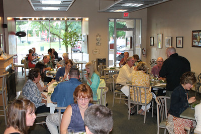 """LAWRENCE PANTAGES / GAZETTE A dinner salad from Marie's Cafe on Public Square with baby kale and Swiss chard, citrus vinaigrette, black pepper mascarpone crouton, a poached egg, pickled turnip and fresh chive was served to 29 participants in a """"progressive dinner"""" held at four restaurants Thursday night by the group Main Street Medina. Marie's Cafe is owned by Brian Hilberg."""