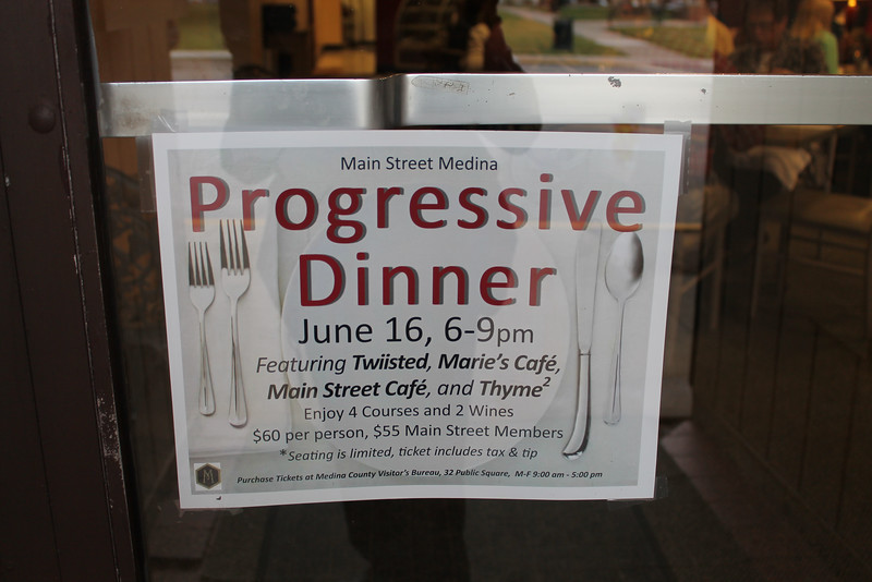 """LAWRENCE PANTAGES / GAZETTE A sign at Marie's Cafe at 117 Public Square in Medina noted that the restaurant was a participant along with Twiisted, Main Street Cafe and Thyme in a Thursday event called a """"progressive dinner."""""""