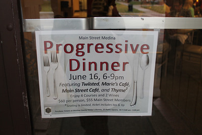"LAWRENCE PANTAGES / GAZETTE A sign at Marie's Cafe at 117 Public Square in Medina noted that the restaurant was a participant along with Twiisted, Main Street Cafe and Thyme in a Thursday event called a ""progressive dinner."""