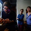 Chris Lann coats the silver with flux while Bonny Kenyon, of Brattleboro, and Indra Tracy, of Dummerston, watch during a silver soldering workshop on Tuesday, Feb. 6, 2018.
