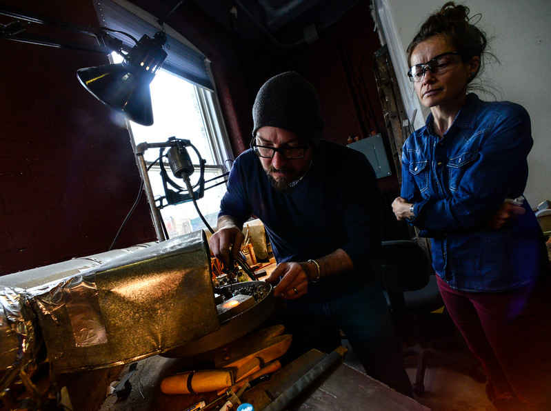 KRISTOPHER RADDER - BRATTLEBORO REFORMER<br /> Chris Lann solders two pieces of silver together while Bonny Kenyon watches during a silver soldering workshop on Tuesday, Feb. 6, 2018.