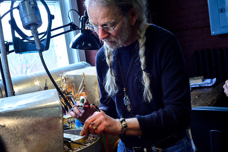 KRISTOPHER RADDER - BRATTLEBORO REFORMER<br /> In a full class, Bob Borter, of Borter's Jewelry Studio, uses silver solder paste to solder two pieces together during a silver soldering workshop on Tuesday, Feb. 6, 2018.