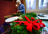 Ruth Lane places pinecones onto a custom wreath on Wednesday, Nov, 30, 2016, for the All Souls Church 2016 Christmas Bazaar that will be held on Friday and Saturday. Lane has been making the wreaths since 1972. KRISTOPHER RADDER - BRATTLEBORO REFORMER