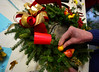 Shirley Ridgway holds a wreath that she just completed on Wednesday, Nov, 30, 2016, for the All Souls Church 2016 Christmas Bazaar that will be held on Friday and Saturday. KRISTOPHER RADDER - BRATTLEBORO REFORMER