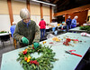 Edith Thomas carefully assembles a wreath on Wednesday, Nov, 30, 2016, for the All Souls Church 2016 Christmas Bazaar that will be held on Friday and Saturday. KRISTOPHER RADDER - BRATTLEBORO REFORMER