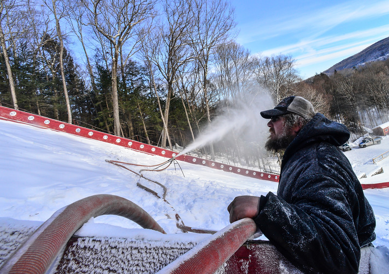 KRISTOPHER RADDER — BRATTLEBORO REFORMER<br /> Matt Butler watches the snow blowing machines after moving them as they start to blow snow at the Harris Hill Ski Jump, in Brattleboro, on Friday, Feb. 1, 2019.