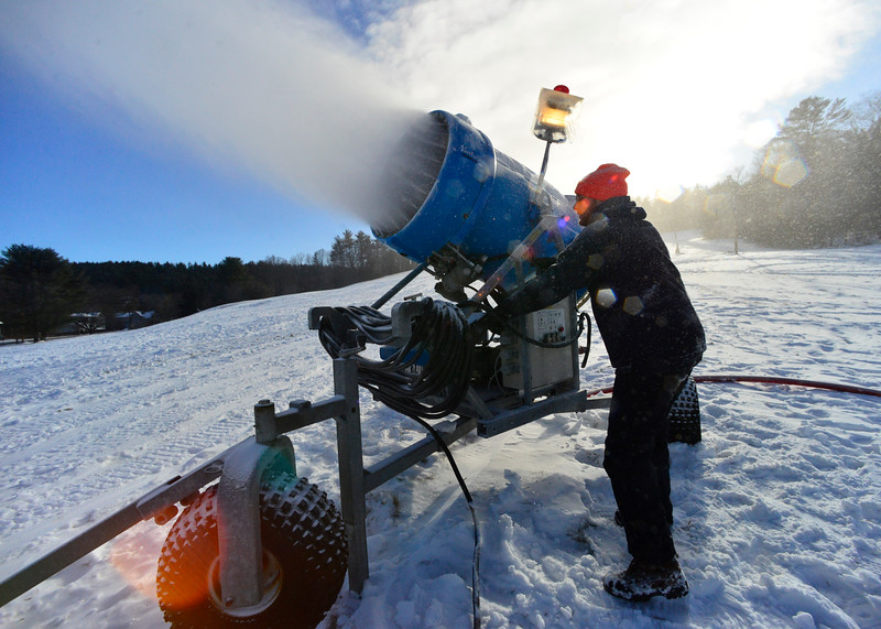 KRISTOPHER RADDER - BRATTLEBORO REFORMER<br /> Zach Rounds adjusts the snow guns at Living Memorial Park on Friday, Dec. 16, 2016.