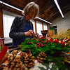 KRISTOPHER RADDER — BRATTLEBORO REFORMER<br /> Heidrun Mayer works on a wreath on Tuesday, Nov. 27, 2018, for the annual Holiday Bazaar at the All Souls Church Unitarian Universalist starting on Friday.