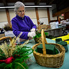 KRISTOPHER RADDER — BRATTLEBORO REFORMER<br /> Carol Barber puts the final touches onto a basket on Tuesday, Nov. 27, 2018, for the annual Holiday Bazaar at the All Souls Church Unitarian Universalist starting on Friday.