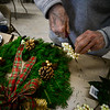 KRISTOPHER RADDER — BRATTLEBORO REFORMER<br /> Lois Reynolds uses a pair of wire cutters to clip some fake berries off as she works on a wreath at the All Souls Unitarian Universalist church on Tuesday, Dec. 3, 2019, for the annual Holiday Bazaar that will happen Friday, Dec. 6, and Saturday, Dec. 7.