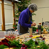 KRISTOPHER RADDER — BRATTLEBORO REFORMER<br /> Kathy Squires works on a wreath at the All Souls Unitarian Universalist church on Tuesday, Dec. 3, 2019, for the annual Holiday Bazaar that will happen Friday, Dec. 6, and Saturday, Dec. 7.