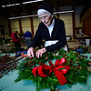 KRISTOPHER RADDER — BRATTLEBORO REFORMER<br /> Ruth Lane works on a wreath at the All Souls Unitarian Universalist church on Tuesday, Dec. 3, 2019, for the annual Holiday Bazaar that will happen Friday, Dec. 6, and Saturday, Dec. 7.
