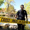 creek drowning001.JPG Boulder Police Officer C. Parker puts up police tape around the scene of an man found at the kid's fishing pond near Boulder Creek on Friday.<br /> Jeremy Papasso/ Camera