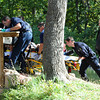 Possible Drowning Victim at Kids' Fishing Pond54.JPG <br /> A man who appeared to be in his mid-50s was pulled from Boulder Creek behind the Boulder County Justice Center this afternoon and transported to Boulder Community Hospital in what police are calling a possible drowning.<br /> Cliff Grassmick / October 7, 2011