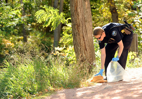 creek drowning003.JPG A Boulder Police Officer gathers evidence from the scene of a man found in the kid's fishing pond near Boulder Creek on Friday.<br /> Jeremy Papasso/ Camera