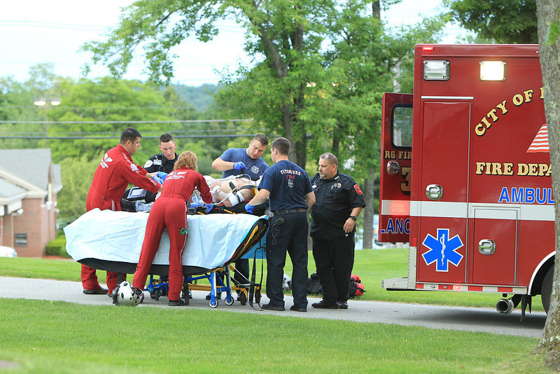 Lifeflight crew along with Fitchburg Firefighters and Med-Star Ambulance prepare paitent for flight -<br /> <br /> photo Scott LaPrade
