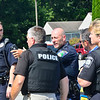 KRISTOPHER RADDER — BRATTLEBORO REFORMER<br /> Walpole Police Chief Michael Paquette directs units where to go from a command that was set up at Walpole Veterinary Hospital on Wednesday, Sept. 11, 2019.