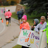 Lee Edberg of Madison Lake, along with his children and nieces and nephews offer 10K runners encouragement along Stoltzman Road while waiting for his wife, Kris, and sister-in-law, Heidi Clow, to pass by on Sunday. Photo by John Cross