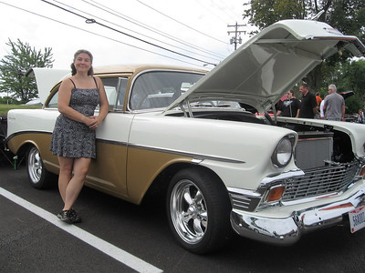 BOB SANDRICK / GAZETTE Erin Redman of Stow said it took 10 years to restore this 1956 Chevrolet 210 Sedan. She is shown with the vehicle Sunday at a Mapleside Farms car show.