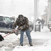 BEN GARVER — THE BERKSHIRE EAGLE<br /> Wayne Cooper shovels slush off of Main Street in West Stockbridge to keep water draining, Friday, March 2, 2018.